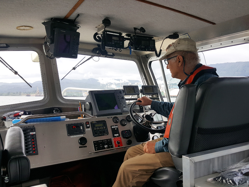 OAIs Bill Newcomb piloting research boat